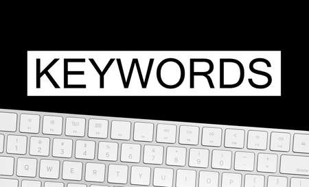 Word Keywords and computer keyboard on black background. SEO direction