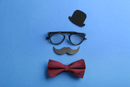 Flat lay composition with glasses and bow tie on blue background. Happy Father's day Stok Fotoğraf