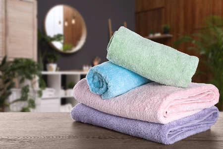 Fresh towels on wooden table in bathroom 스톡 콘텐츠 - 146378350