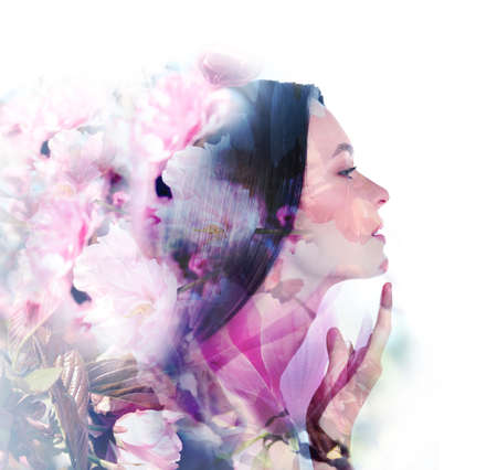 Double exposure of beautiful woman and blooming flowers