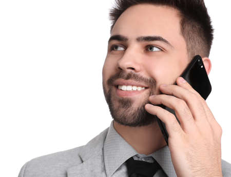 Young businessman talking on smartphone against white background