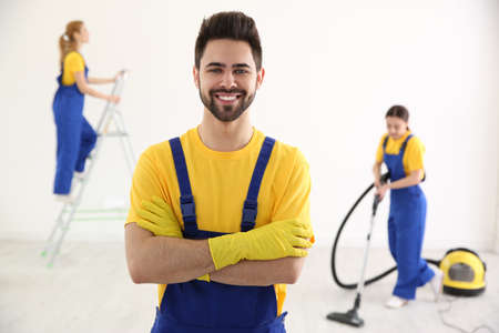 Professional janitor in uniform indoors. Cleaning service