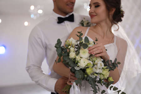 Happy newlywed couple together in festive hall, focus on hands