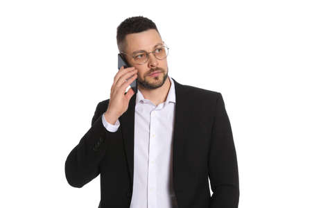 Businessman in glasses talking on smartphone against white background