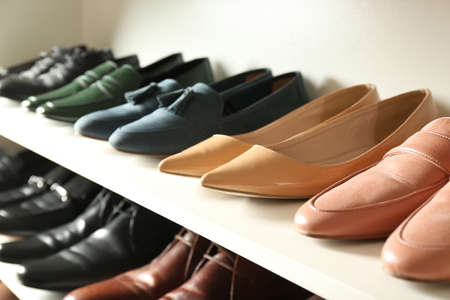 White shelving unit with different leather shoes
