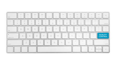 Modern computer keyboard and quality control button isolated on white, top view
