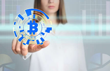 Fintech concept. Woman using virtual screen with bitcoin symbol Banque d'images