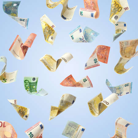 Set of falling money on blue background. Currency exchange