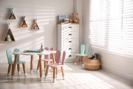 Small table and chairs with bunny ears in children's room interior Фото со стока - 147280935
