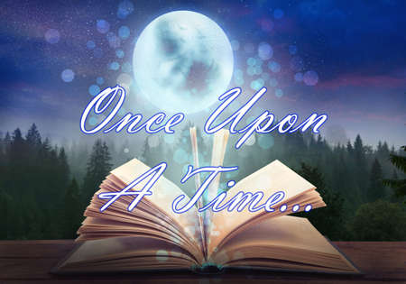 Magic book of fairy tales against landscape with forest and full moon at night
