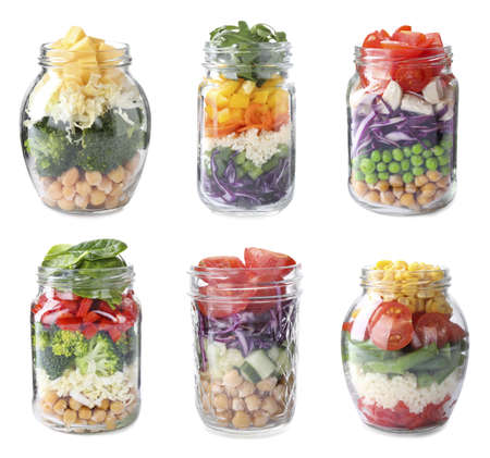 Set of different jars with healthy salads on white background