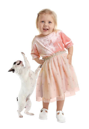 Cute little girl with her pet on white background