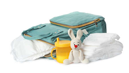 Backpack with disposable diapers and child's accessories on white background Banque d'images