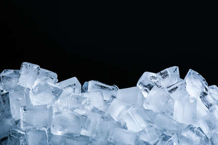 Ice cubes on black background, closeup view 免版税图像