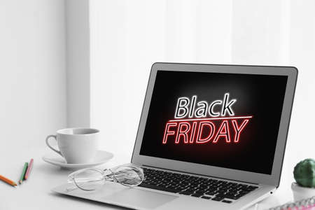 Black Friday announcement on laptop screen. Online shopping