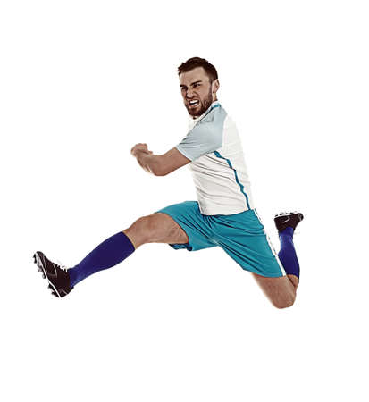 Young man playing football on white background Foto de archivo