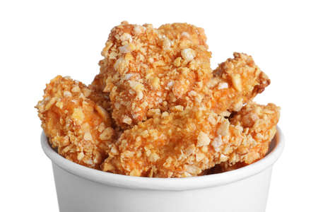 Bucket with yummy fried nuggets on white background, closeup