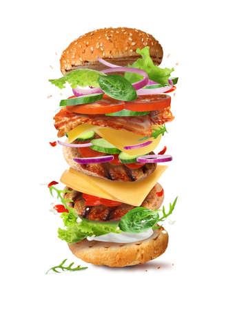 Delicious burger with different flying ingredients on white background