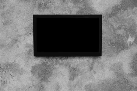 Modern TV on grey wall. Space for design