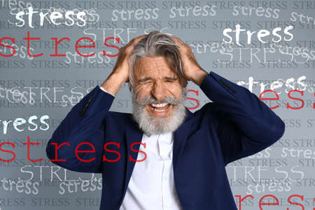 Man suffering from depression and words STRESS on grey background