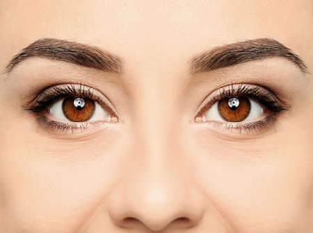 Beautiful woman with perfect eyebrows, closeup view