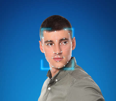 Facial recognition system. Young man with scanner frame and digital biometric grid on blue background