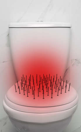 Hemorrhoid concept. Toilet bowl with nails near marble wall