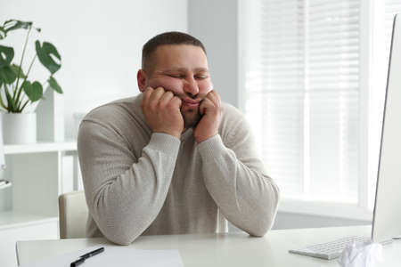 Lazy overweight office employee procrastinating at workplace