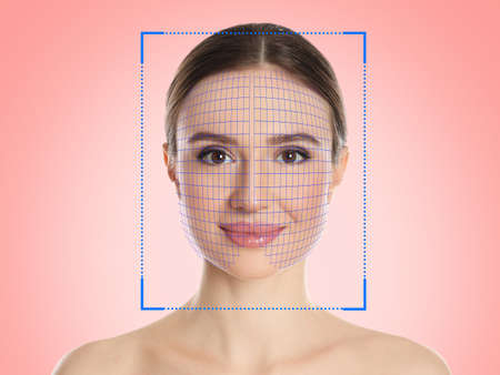 Facial recognition system. Woman with scanner frame and digital grid on pink background