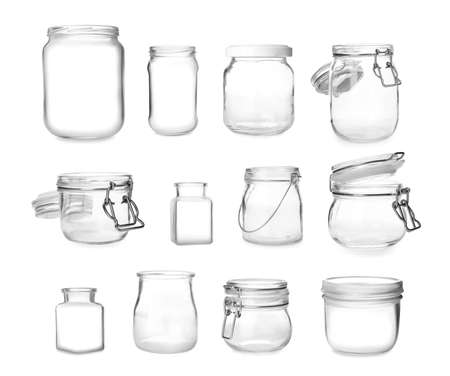 Set with different empty glass jars on white background