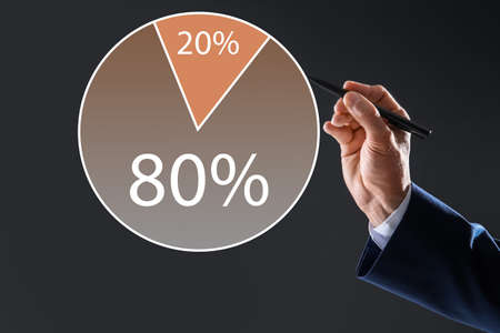 Pareto principle concept. Man drawing chart with 80/20 rule representation on grey background, closeup