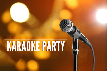 Modern microphone and text KARAOKE PARTY on blurred background