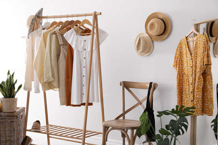 Rack with stylish women's clothes indoors. Interior design