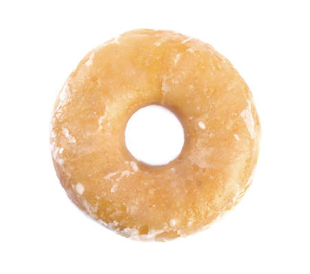 Sweet delicious glazed donut isolated on white, top view