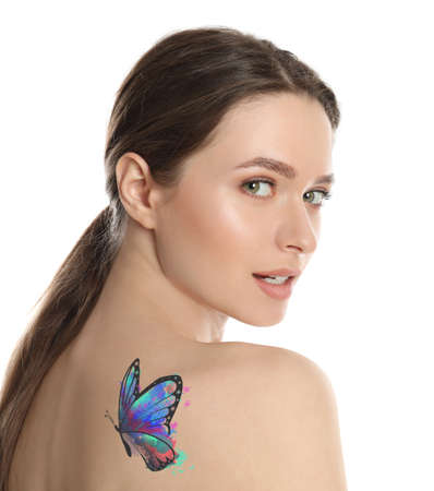 Young woman with colorful tattoo of butterfly on her body against white background Banque d'images