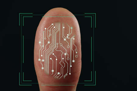 Man using biometric fingerprint scanner on dark background, closeup