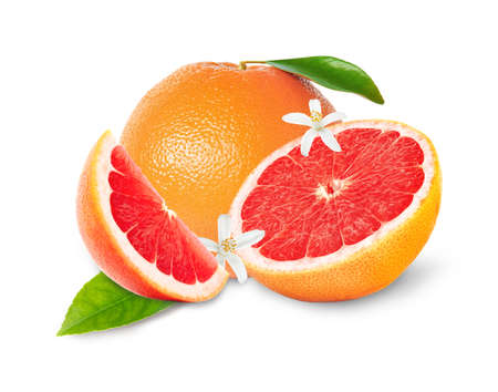 Whole and cut grapefruits on white background Stock Photo