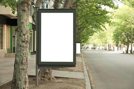 Blank advertising board on city street. Space for design Stock fotó