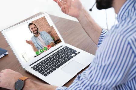 Man using video chat for online job interview in office, closeup Reklamní fotografie