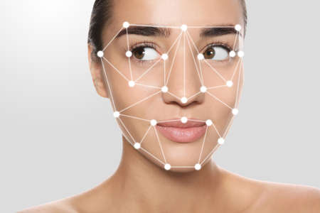 Facial recognition system. Woman with digital biometric grid on light background, closeup