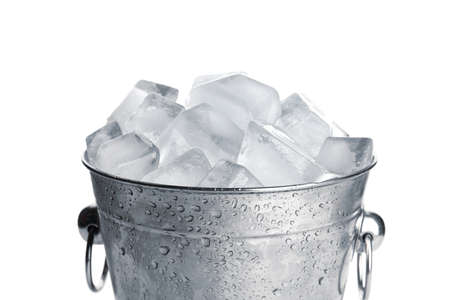 Metal bucket with ice cubes isolated on white Reklamní fotografie