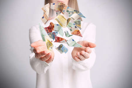 Woman with money on light grey background, closeup. Currency exchange 写真素材