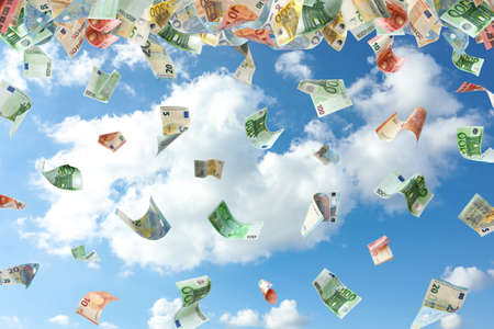 Falling Euro banknotes and blue sky on background. Money rain