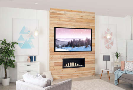 Living room interior with modern TV on wooden wall Foto de archivo