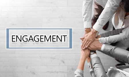 Engagement concept. People holding hands together, top view  Banco de Imagens