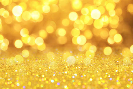 Gold glitter with bokeh effect as abstract background