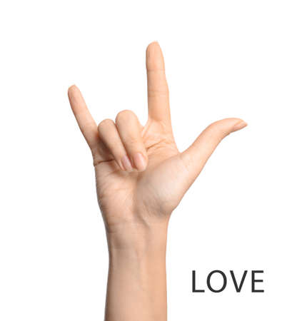 Woman showing word Love on white background, closeup. American sign language