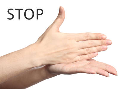 Woman showing word Stop on white background, closeup. American sign language