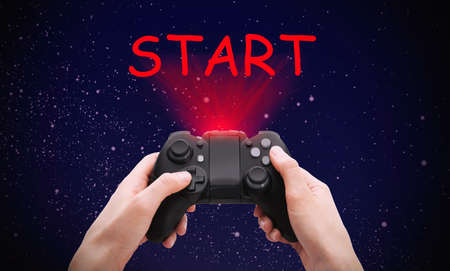 Woman with video game controller and word START against night sky, closeup