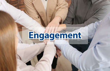 Engagement concept. People holding hands together, above view